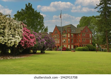 Salem, Oregon, USA - May 16, 2018: Willamette University campus, oldest university west of the Mississippi - an angular, distant view of Eaton Hall, an academic building, blue sky with white clouds