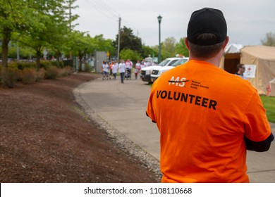 Salem, Oregon / USA - May, 5 2018: Multiple Sclerosis Walkathon Backside View of Volunteer Watching Walkers Approach the Finish Line