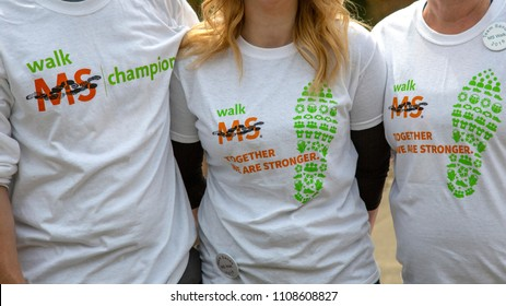 Salem, Oregon / USA - May, 5 2018: Multiple Sclerosis Walkathon /Partial isolated view of 3 people wearing supportive Multiple Sclerosis/MS Walkathon t-shirts