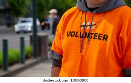 Salem, Oregon / USA - May, 5 2018: Multiple Sclerosis Walkathon / Partial view of Multiple Sclerosis Volunteer in Orange Shirt
