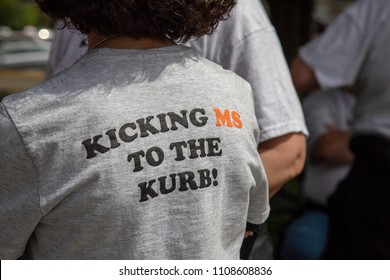Salem, Oregon / USA - May, 5 2018: Multiple Sclerosis Walkathon /Partial view of backside of a woman wearing a supportive Multiple Sclerosis/MS Walkathon t-shirt