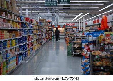 Salem, Oregon / USA -  October 11, 2017: discount supermarket aisle with one customer
