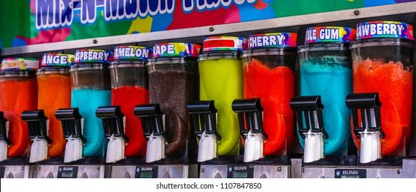 Salem, Oregon/USA - September 4, 2016: Rainbow-colored slush dispensers in the state fair.