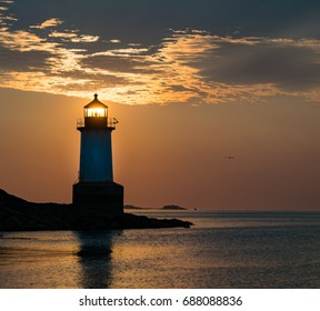 Salem Sunlight passing through Lighthouse at Dawn