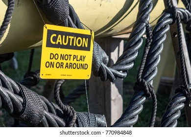 "Salem, USA - November 29 2017: Sign ""Caution - Do not play on or around"" in the Salem harbor."