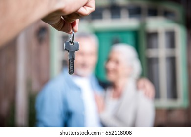 saleman giving keys of new house to new owners, selective focus