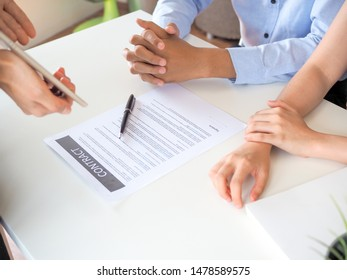 Saleman or Male real estate agent explaining all the contract buying to young couple. for real estate, sale, buying, meeting, insurance concept