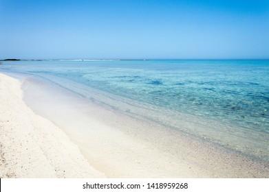 Salento coastal landscape with white beaches and clear sea