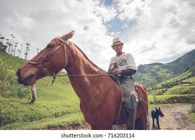 SALENTO, COLOMBIA - APRIL 20, 2014: Local farmer in the Cocora Valley near Salento, Colombia
