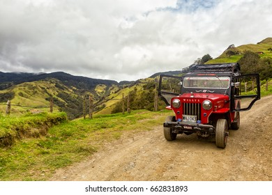 SALENTO, COLOMBIA - JUNE 7: Landscape view of a red jeep used for tours with the doors open in the mountains outside of Salento, Colombia on June 7, 2016.