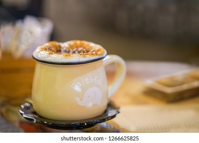 A Salep(turkish hot drink) with plenty of foam in a special glass