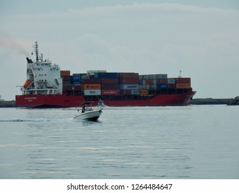 Salerno, Campania, Italy - December 6th 2018: Container ship as it exits from the port of Salerno