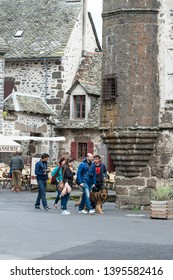 SALERS, FRANCE - APRIL 16, 2017: Tourists walking by the medieval historical village cento.