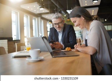 Sales business meeting between man and woman in modern office space