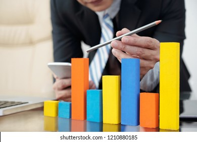 Sales manager analyzing ascending trend