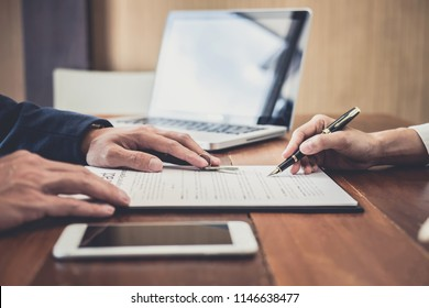 Sales manager filing keys to customer after signing rental lease contract of sale purchase agreement, concerning mortgage loan offer for and house insurance.