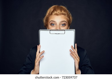 sales manager woman holding a folder with documents on a black background