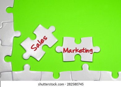 Sales Marketing word on white puzzle - Business Concept