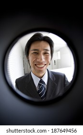sales person seen through peep window