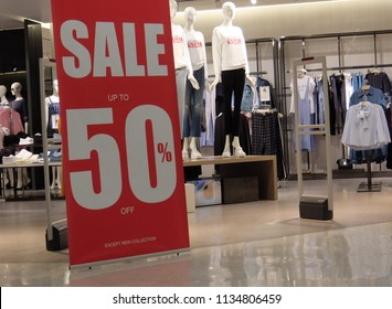 sales promotion of woman fashion clothes retail store in shopping mall. store front display for fashion background.