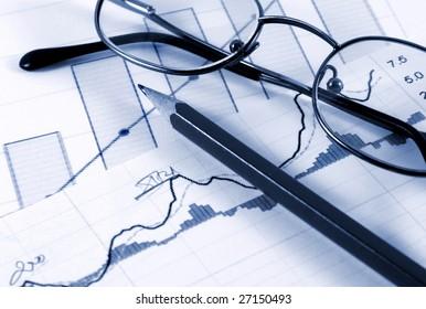 Sales report concept; diagrams,pen and glasses