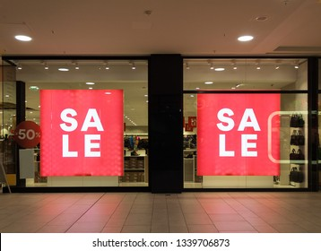 sales sign fifty percent off sign on a store front