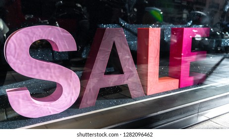 Sales sign on the vitrine. Big different colored letters saying sales. Living coral color. Colorful mock-up.