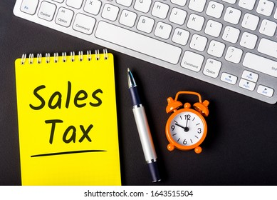 Sales Tax - from the consumer at the point of purchase or online shop. Shopping and taxation. Workplace of an accountant