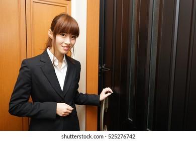 sales woman at entrance