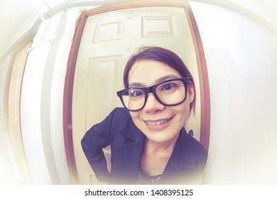 Sales woman knocking  doors at condominium