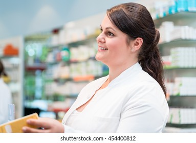 Sales woman in pharmacy or drug store presenting product to customer