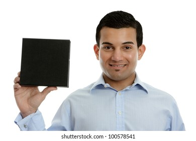 A salesman, businessman, teacher or other occupation holding a product, book or other merchandise in one hand and smiling.  White background.