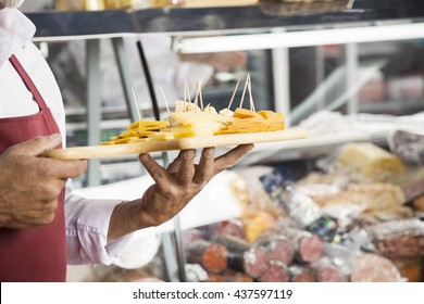 Salesman Holding Cutting Board With Assorted Shop