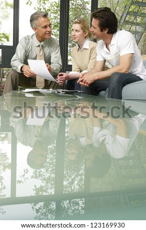 salesman investment advisor sitting clients giving stock photo edit