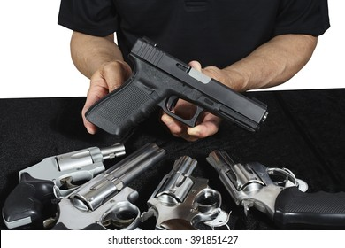 Salesman selling pistols and revolver assorted firearms for sale at gun show