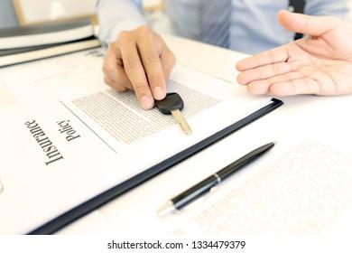 Salesman send key to customer after good deal agreement, Concept of car insurance, rental, sales.