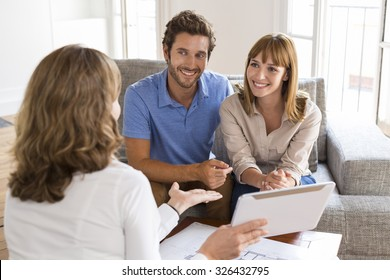 Saleswoman presenting a new project property on digital tablet