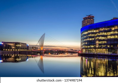 Salford, North England, 10th August 2017. An Evening View of the Footbridge crossing the Salford Quays canal at Media City UK with the BBC studios to the right and ITV studios to the left.