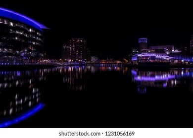 Salford Quays, England, UK,  October 9, 2018 A Night time landscape using long exposure of Media City UK showing reflections on the Manchester Ship Canal at Salford Quays