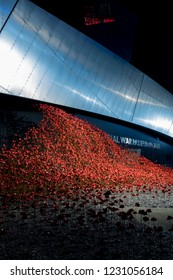 Salford Quays, England, UK,  October 9, 2018 A Night time landscape using long exposure of Media City UK showing the red poppy sculpture wave at Salford Quays