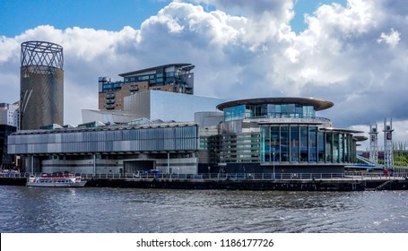 Salford Quays, UK - August 24,2018: the Lowry as viewed from mediaCityUK television and radio broadcast centre in Salford, UK