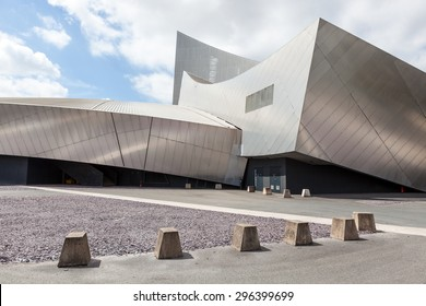 SALFORD, UK - MAY 23, 2015: The futuristic architecture of the Imperial War Museum North is designed by Daniel Libeskind.