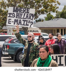"Salinas, California - May 25, 2016: Protesters hold signs in front of the Hillary Clinton rally at Hartnell College, including one sign that reads: ""Where is Hillary E-Mails?"""