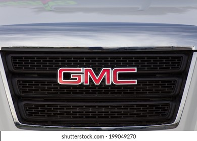 SALINAS, CA/USA - JUNE 14, 2014: GMC logo and grille. General Motors Corporation is an American automobile division of the American manufacturer General Motors.
