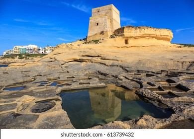 Salinas excavated in the rock. Island Gozo in Malta