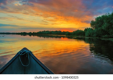 Saling in the Danube delta at sunset, Romania