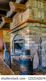 Salisbury, Australia - Dec 27, 2017: Rustic old European inspired fireplace design elements in Salisbury Lodges; an architectural centerpiece welcomes guests in the spacious main living room.
