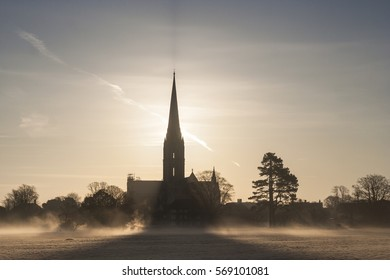 Salisbury cathedral across the Harnham Water meadows.
