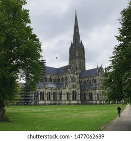 Salisbury Cathedral, Salisbury, UK with a cloudy sky