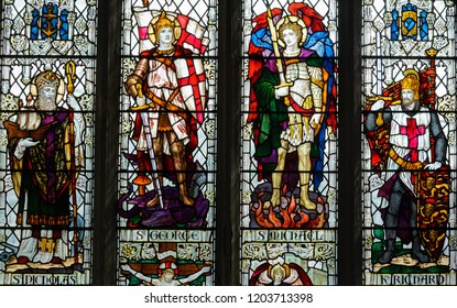 Salisbury, England - Sep 1, 2018: St Thomas and St Edmunds Church - Memorial Window in the South Aisle - Central Lights; Nicholas, George, Michael and King Richard; circa 1920